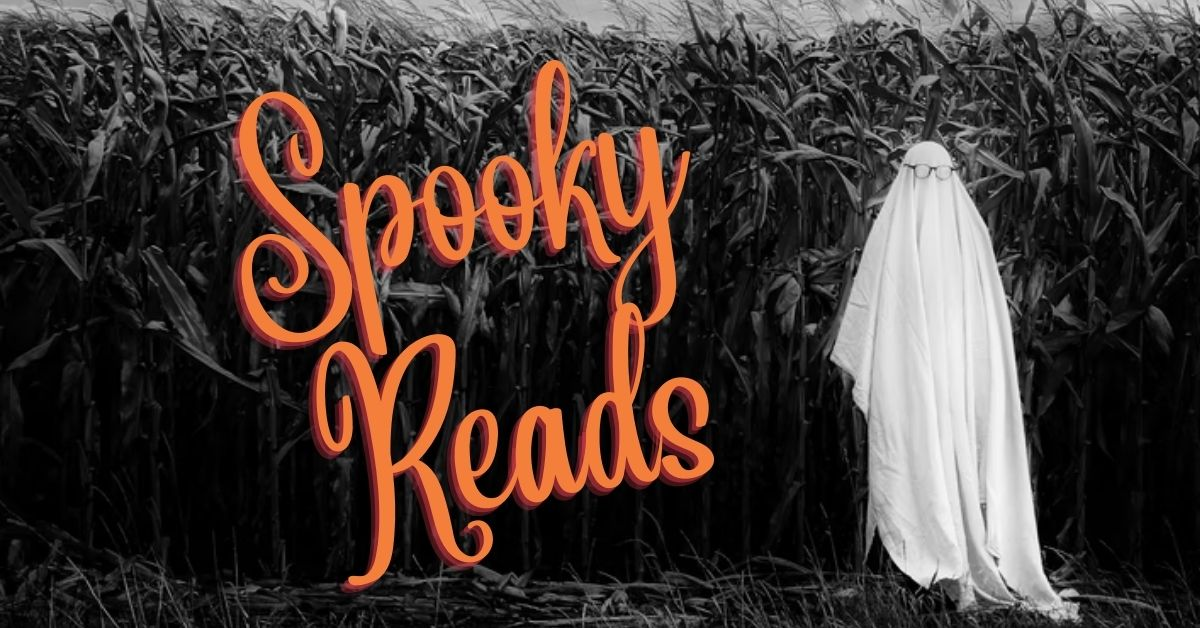 A ghost stands in a corn field. Text says spooky reads