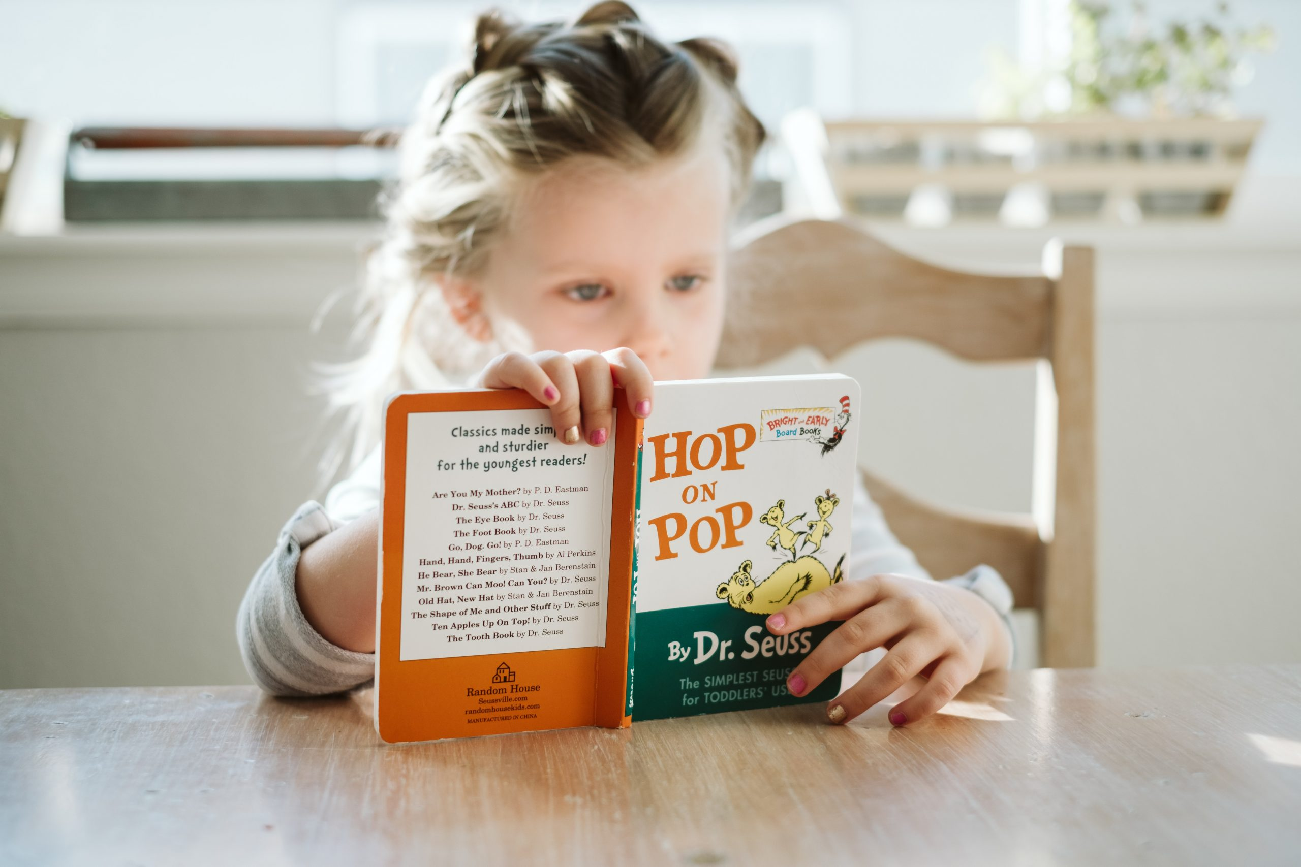 A child reads Hop on Pop by Dr. Seuss