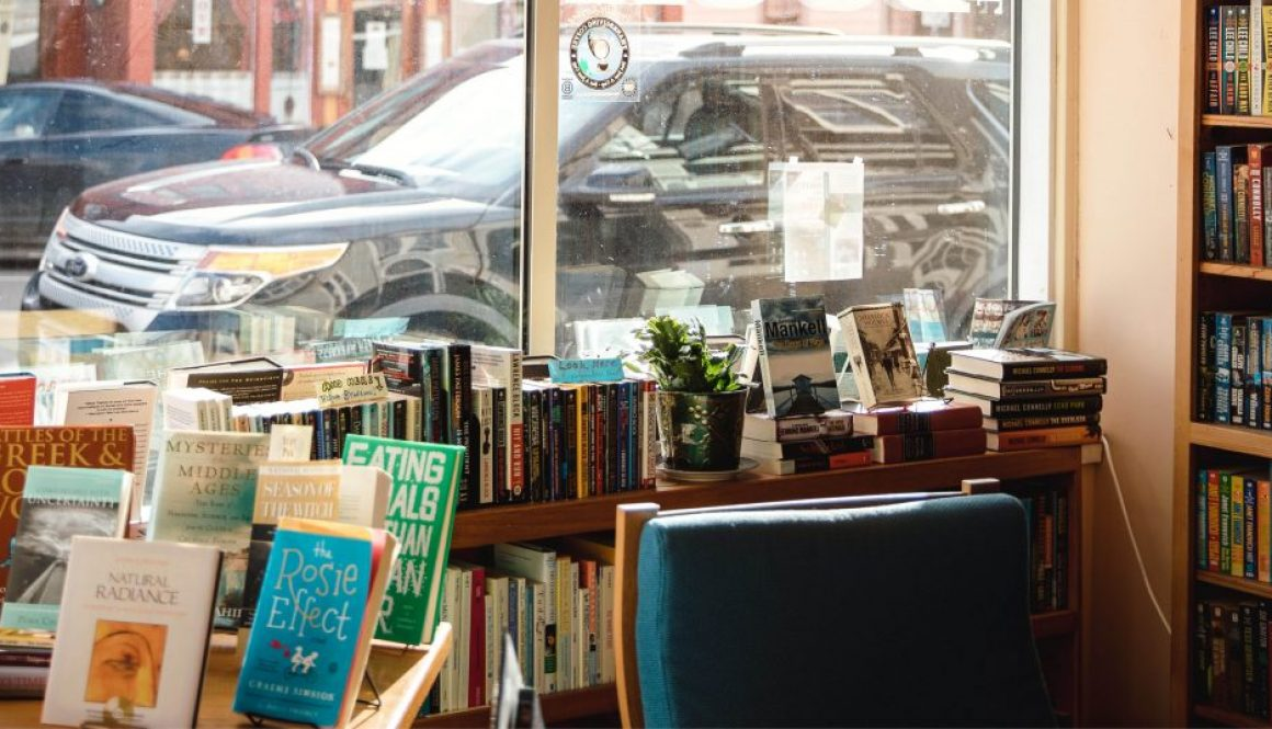 A view from inside a library with a car visible from outside the window.